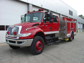 HME Ahrens Fox International 4400 | 4dr w/ stainless body and subframe, 38000 gvw, 330hp, 1250 pump, 1200 gal. poly tank, LED warning lights, plumbed for deck gun, roll up crosslays, striped